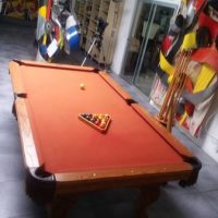 Billiards table with pool cues/rack